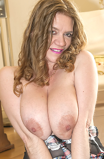 LilyMay - Lily May is a mature and curvy adult glamour model from Wales with mouth watering and all natural 34F tits. A must see for all big boob fans
